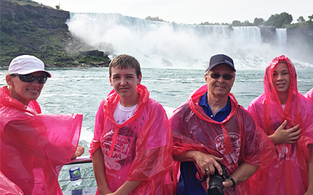 People With Niagara Falls Background